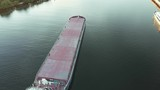 Top view of empty barge without cargo float along the river in summer sunny day - 224819147