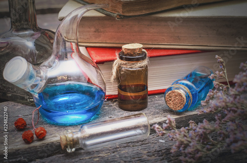 Essential oil bottles and old books  Herbal medicine  Magic