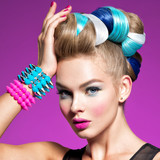 Fashion model with bright makeup and creative hairstyle
