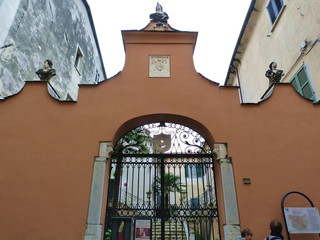 Entrance gate to the former bishop's palace, Sarzana, Italy