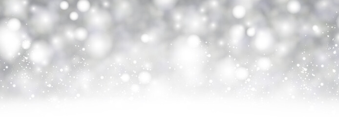 Grey shiny blurred winter banner with snow.
