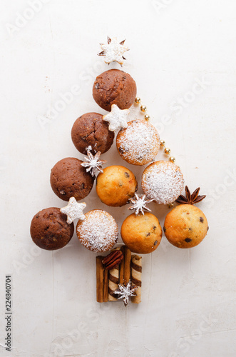 Foto Murales Assorted muffins in the shape of a Christmas tree  on the white textured background. Top view.
