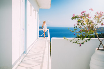 Summer travel tourist girl on the Mediterranean island house balcony