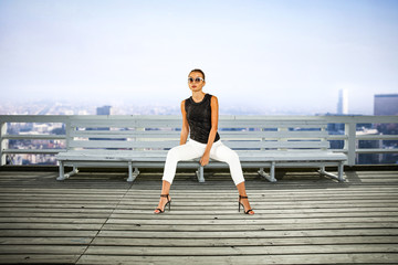 Slim young woman in city and free space for your decoration.