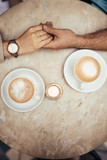 Hands of couple together on a coffee table - 224884752