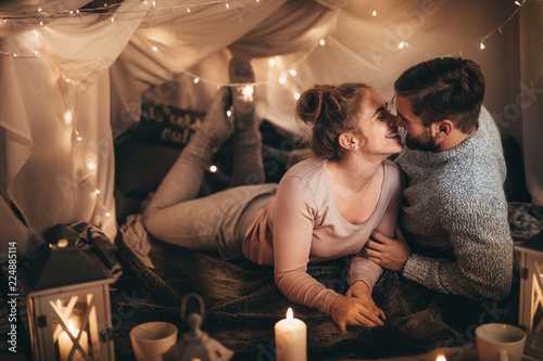 Couple on bed together in romantic mood © Jacob Lund