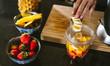 Female making mix fruit smoothie