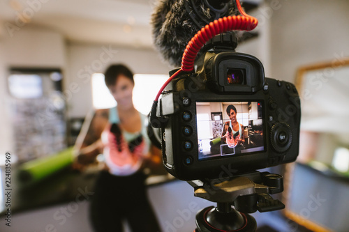 Social media influencer recording video for blog