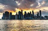 New York City Manhattan midtown panorama at sunset  viewed from Brooklyn Bridge park - 224890391