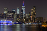 Long time exposure of New York City Manhattan downtown skyline at night viewed from Brooklyn Bridge park - 224890523