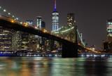 Long time exposure of New York City Manhattan downtown skyline and Brooklyn Bridge  at night viewed from Brooklyn Bridge park - 224890543