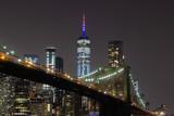 New York City Manhattan downtown skyline and Brooklyn Bridge  at night viewed from Brooklyn Bridge park - 224890572