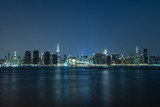 Long time exposure of New York City Manhattan midtown skyline at night viewed from Transmitter Park - 224890594