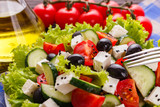 Greek salad on a wooden rustic background - 224914947