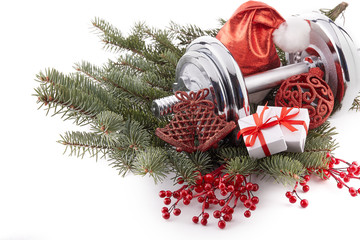 Dumbbell and Christmas decorations. Fitness.