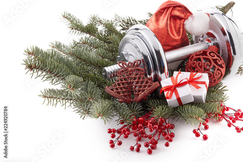 Dumbbell and Christmas decorations. Fitness. - 224920784
