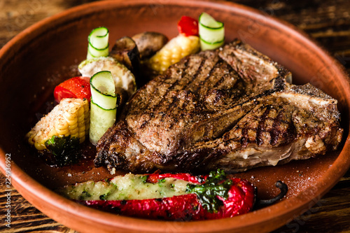 chic delicious steak with vegetable garnish - 224936952