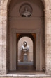 Quadro Sculpture of a male bust in a small courtyard