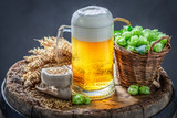 Gold pint of beer on wooden barrel - 224992994