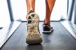 Leinwanddruck Bild - Male muscular feet in sneakers running on the treadmill at the gym.