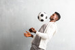 Leinwanddruck Bild - African american sportman holding a soccer ball