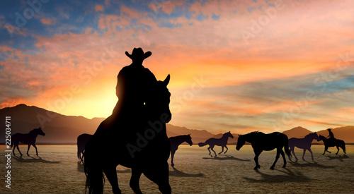 Cowboy leading horse herd