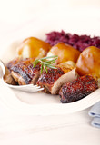Duck breast with potato dumplings and red cabbage. Concept for a tasty and hearty dish. Bright wooden background.  - 225042170