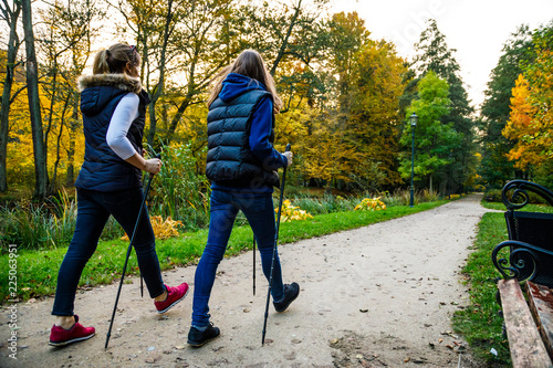 Foto Murales Nordic walking - active people working out in park