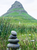 Balanced stones in the background of the Kirkjufell mountain. Iceland
