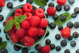 Delicious fresh raspberries in a bowl.