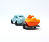 Isolated Blue Toy Car With Trailer Which Carrying Jetski On It