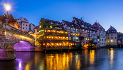 Sunset along the Ill River in Petite France areas of Strasbourg in the Alsace region of France.