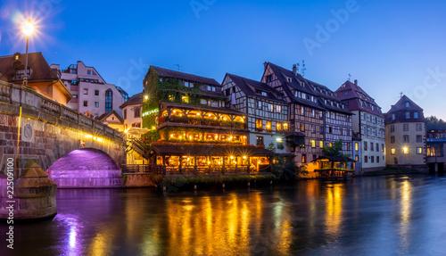 Leinwandbild Motiv Sunset along the Ill River in Petite France areas of Strasbourg in the Alsace region of France.