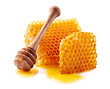 Quadro Honeycomb with honey on white background