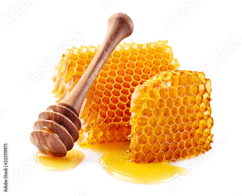 Honeycomb with honey on white background © Dionisvera