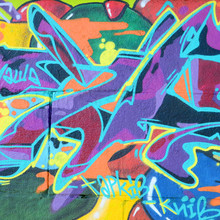 """Постер, картина, фотообои """"Fragment of graffiti drawings. The old wall decorated with paint stains in the style of street art culture. Multicolored background texture"""""""