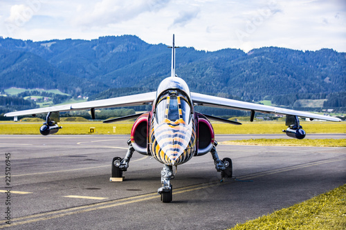 Parked jet airplane on runway