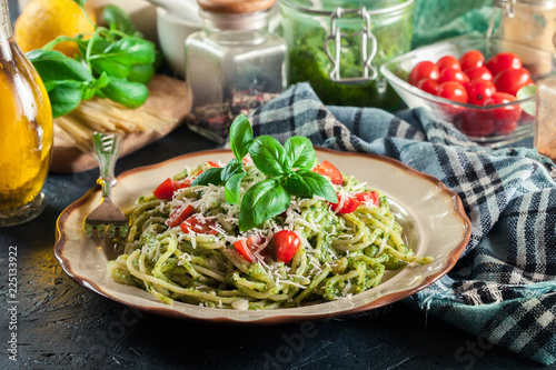 Vegetarian pasta spaghetti with basil pesto and cherry tomatoes