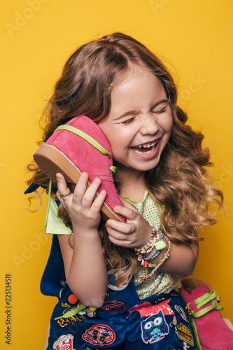 Foto Murales Young fashion model on an orange background, fashion kid