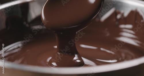 fototapeta na ścianę closeup pouring melted dark chocolate from spoon