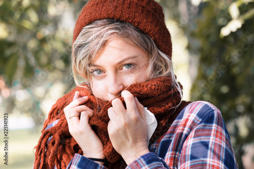 Leinwanddruck Bild Young woman wearing woolen cap and scarf outdoor