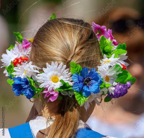 Wreath of flowers on the head of a girl