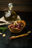 Assorted of marinated olives with herbs and rosemary - 225152132