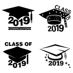 Four black and white graduation sticker or label designs on an isolated white background