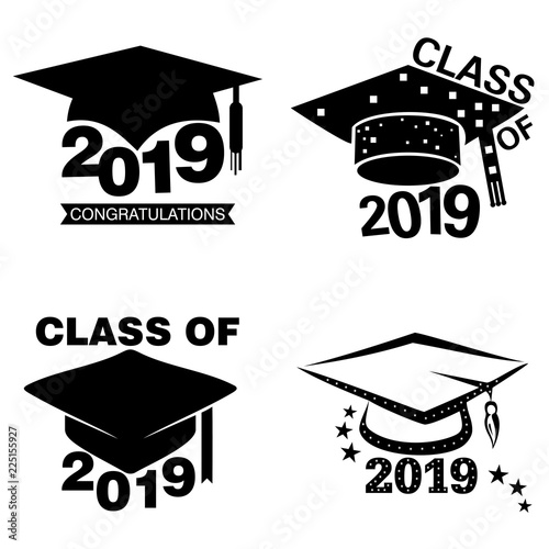 Four black and white graduation sticker or label designs on an isolated white background © tharun15