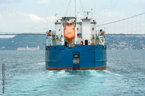 Fototapeta View of modern safety lifeboat carried by a cruise ship for use in emergency evacuation