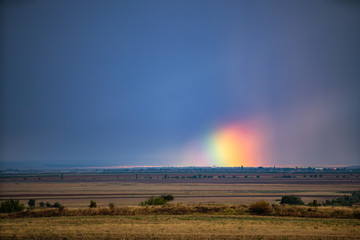 Rainbow and sky background in the countryside © ValentinValkov