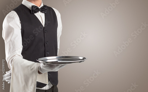 Leinwanddruck Bild Waiter serving with white gloves and steel tray in an empty space