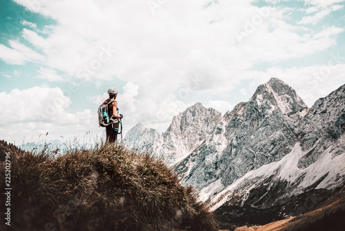 hiker on the top of mountain