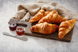 fresh croissants with fruits jam
